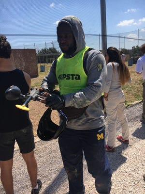The Michigan football team played paintball in Rome.