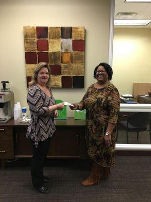U.S. Bank's Marcie Wilkins presents her bank's donation.