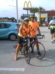 Vero Cycling Club members Jean and Jake Piper pause at the McDonalds on Route 1 where Kevin Adorno of Connecticut last his life in 2014. Their tee shirts carry the logo that Kevin is still remembered by: Roll Hard or Go Home!