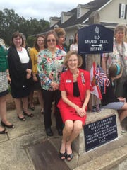 Members of Tallahassee's Caroline Brevard chapter of the Daughters of the American Revolution pose in October 2015 in front of the Old Spanish Trail marker at Brevard and Monroe streets. The DAR put up the original marker in 1933 and restored it in 2015.