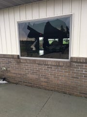 Windows were busted in a storm that brought golf-ball