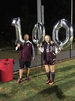Nutley coach Mike DiPiano with Zoe Steck after her 100th career goal. The Raiders have talented leaders to take over for the graduated Steck.
