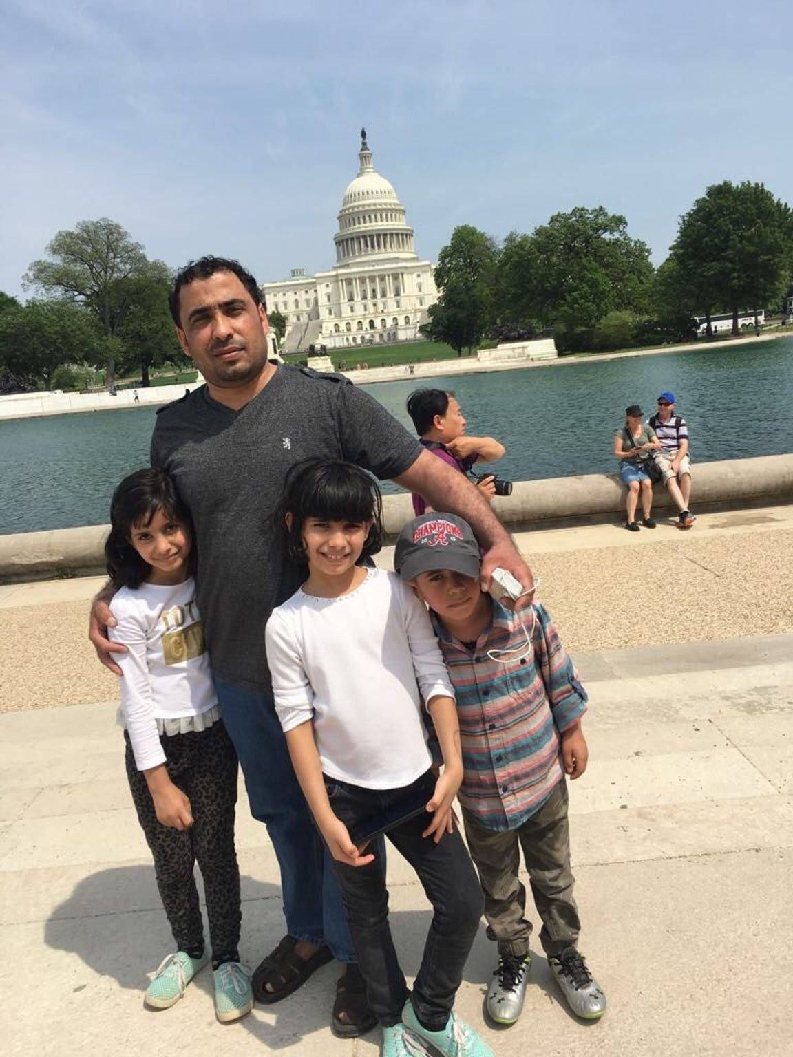 From left to right: Sham Abu-HJaze, Anas Abu-HJaze, Fagar Abu-HJaze and Wisam Abu-HJaze pose for a photo while visiting Washington, D.C.