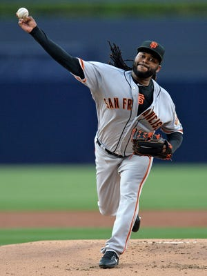 San Francisco Giants starting pitcher Johnny Cueto (47) pitches during the first inning against the San Diego Padres at Petco Park.
