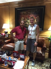 Jacob Conover with Alabama coach Nick Saban.