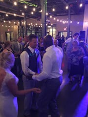 Donald Driver, right, chats with newlyweds Joe and