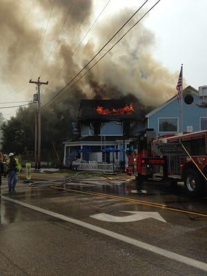 Crews work to put a fire out at Shipwrecked Brew Pub in Egg Harbor.