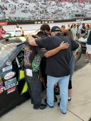 NASCAR Crew Chief Keith Wolfe huddles with his team
