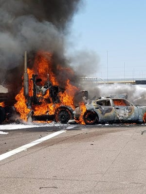 A semitruck caught fire after crashing into another vehicle on Interstate 10 in Chandler on Aug. 29, 2017.