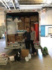 Kate Banaszak, left, of Smyrna, and Ashleigh Hudson, right, of Rehoboth Beach, drove for 15 hours to deliver a U-Haul full of supplies for Houston to a disaster relief company in Tennessee.