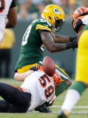 Green Bay Packers tight end Martellus Bennett (80) drops a pass in the fourth quarter against the Cincinnati Bengals on Sunday, Sept. 24, 2017, at Lambeau Field.