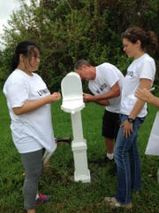 Some volunteers restored mailboxes so residents could