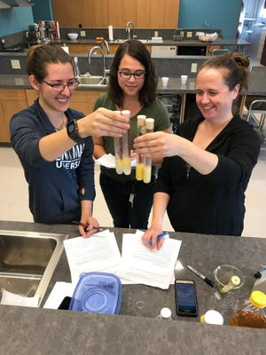Emily Boutcher (from left) Stephanie Lopez and Marie Shoemaker, students in the food science chemistry program at Mount Mary University in Milwaukee, work in the new food science lab at the school last week.