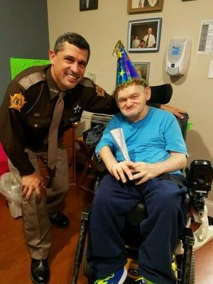 Deputy Jason Thomas stopped by to wish Breckinridge resident Danny Baird a happy birthday this week.
