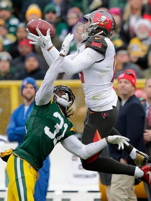 Green Bay Packers cornerback Davon House (31) defends against Tampa Bay Buccaneers wide receiver Mike Evans (13) Sunday, December 3, 2017, at Lambeau Field in Green Bay, Wis.