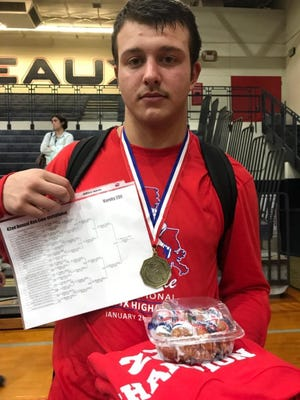 Haugnton's DJ Monroe won the 220-pound title at the 42nd Ken Cole Invitational.