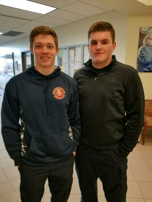 Aaron Kinney (left) and Ryan Rinehart were two of the original students in the Western Lakes Fire Explorers Post 4732 and recently became State of Wisconsin Firefighter 1 certified.