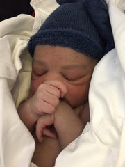 Toyin Ogundipe gave birth to her son, Jake, on a flight from Paris to N.Y. with help from UM alum Sij Hemal.