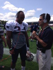 Play-by-play announcer Bob Socci interviews former New England running back Shane Vereen.