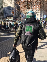 A Philadelphia Eagles fan wears a Philly Special coat at the team's Super Bowl parade.