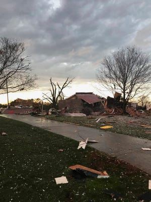This photo provided by Johnny Tribble shows a damaged house after a tornado, Tribble said, passed the area in Ardmore, Ala., Monday.