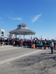 Protesters from March for Our Lives gather at the Rehoboth Beach Bandstand to listen to speakers on Saturday, March 24, 2018.