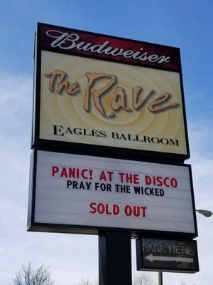 A church near the popular concert venue The Rave/Eagles Club lets music fans park in its lot for donations. That led to a tax dispute between the church and the city.