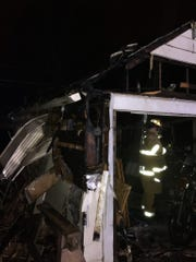 Fond du Lac Fire/Rescue is pictured responding to a garage fire Monday night.