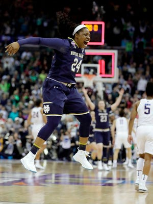 Notre Dame's Arike Ogunbowale celebrates as Connecticut's Crystal Dangerfield walks away as time expires in overtime.