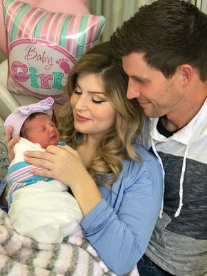 Erin (Bates) Paine and her husband, Chad, hold their daughter Everly Hope, who was born March 30.