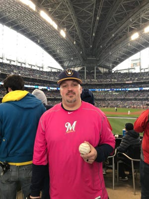 Brian Moeller of Milwaukee caught the first Miller Park home run of 2018, a blast to right center by Manny Pina.