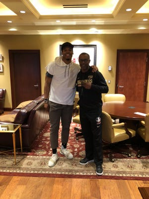 Florida State head coach Willie Taggart takes a picture with former Auburn Heisman winner Cam Newton during a campus visit.