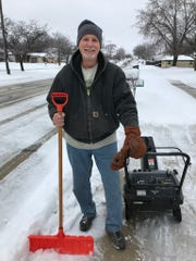 Glen Farrell clears snow from his driveway in South Milwaukee on Sunday.