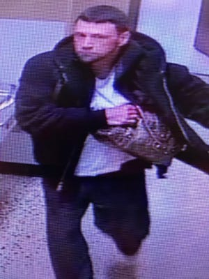 Who is this suspected purse snatcher?
