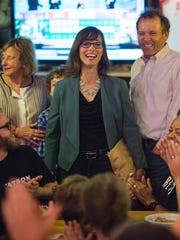 Liz Watson, flanked by supporters, celebrates her Tuesday