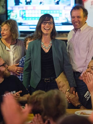Liz Watson, flanked by supporters, celebrates her Tuesday night victory in a Democratic primary in Southern Indiana.