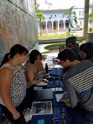 Staff from Paterson school district recruiting teachers in April at the University of Puerto Rico