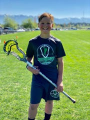 Parker Stimac, 12, plays on a lacrosse team coached