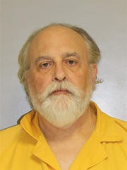 Paul Ressler, 61, is charged with neglect of animals after several dogs were dropped off at a shelter showing signs of severe neglect.