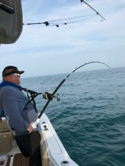 Nick Skidmore attempts to reel in a thresher shark