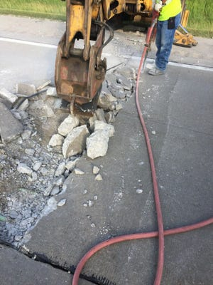 """State road crews had a busy weekend repairing a portion of I-69 at the Cochran Road exit in Charlotte. The road was """"buckling"""" due to extremely hot weather, an MDOT official said."""