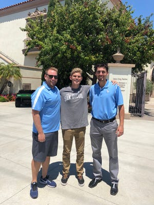Jackson Garcia with USD coaches Christian Taylor (co-offensive coordinator) and Tyler Sutton (special teams coordinator).