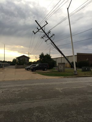 A 69 KV transmission line lists at a nearly 45-degree angle after a strong storm system hit Springfield Thursday night.