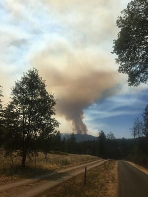 The Taylor Creek Fire near Grants Pass was very active Thursday.