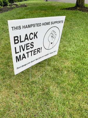 Mic Gordon, a trustee and vice president of the Hampsted Village Homeowner's Association, created and distributed signs supporting the Black Lives Matter movement in his neighborhood. A social-media post by the homeowners association meant to remind residents of the guidelines for removal of such temporary signs has sparked controversy.