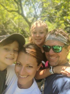 Nick Freitas, Somerset Berkley Regional High School teacher and coach, with wife Stephanie, daughter Stellah and son Emmett.