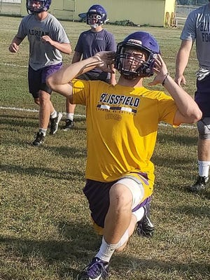 Blissfield quarterback Gavin Ganun stretches before the first practice of the season. Ganun is looking to lead the Royals in his fourth and final season under center.