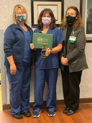From left, Sondra Fettes, Labor and Delivery Nurse Director, Dusti Donbrock, RN, and Mary Rose, Chief Nursing Officer and VP of Patient Care Services.