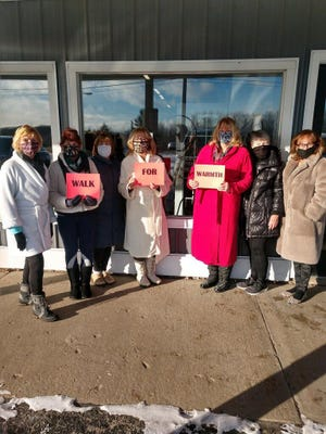 """""""Stephanie's Core Queens"""" Marianne Ray, Cindy Taylor, Patty Gildner, Elaine Butts, Karen Wilson, Sue France and Mary Hebert, recently completed their walk as a part of the Walk for Warmth in Cheboygan County. Walkers who want to participate in this still have until the end of the month to finish their walk. Courtesy photo"""