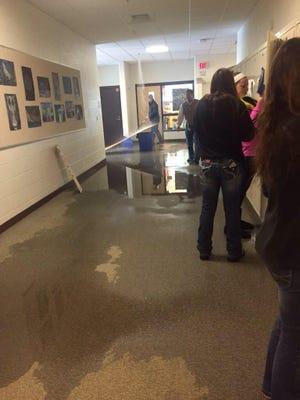 A frozen sprinkler line burst Monday, sending water into hallways at Lakeview High School.